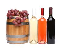 Barrel and bottles of wine and ripe grapes. On wooden. A white background Stock Images