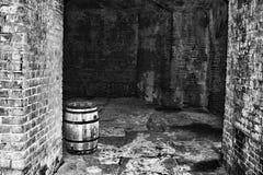 Barrel in Brick Cellar Stock Images
