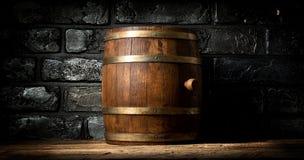 Barrel and brick wall Stock Image
