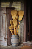 Barrel of Brooms stock image