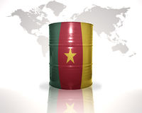 barrel with cameroon flag on the world map Stock Photos