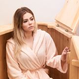 Barrel cedar. Wellness spa sauna. Aromatherapy treatment. Young beauty woman. Girl face.  stock photography