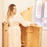 Barrel cedar. Wellness spa sauna. Aromatherapy treatment. Young beauty woman. Girl face.  stock images