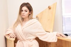 Barrel cedar. Wellness spa sauna. Aromatherapy treatment. Young beauty woman. Girl face.  royalty free stock photo