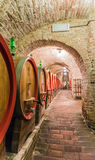 The barrel cellar of Montepulciano red wine. The barrel containing the red Montepulciano wine noble in Siena, Tuscany Royalty Free Stock Photography