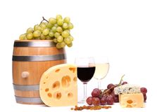 Barrel, cheeses, glasses of wine and ripe grapes. On wooden on a white background Stock Images