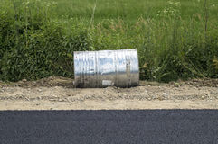 Barrel discarded by the road Royalty Free Stock Image