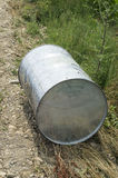 Barrel discarded beside the road Stock Images