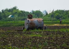 Barrel with fertilizers in the field Stock Photo
