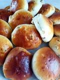 A barrel of fresh freshly baked buns of raisins stock photo