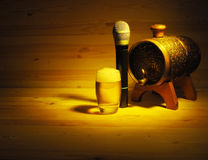 Barrel and glass of beer, microphone on wooden background. concept karaoke Stock Photography