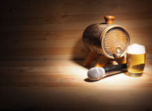 Barrel and glass of beer, microphone on wooden background. concept karaoke Stock Images