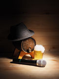 Barrel and glass of beer, microphone on wooden background. concept karaoke Stock Photos