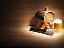 Barrel and glass of beer, microphone on wooden background. concept karaoke Royalty Free Stock Image