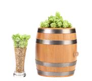 Barrel and glass with hop barley. Stock Photos