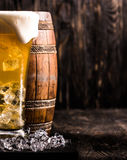 Barrel and glass of light beer with ice and lemon Stock Image