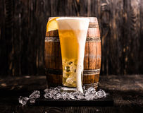 Barrel and glass of light beer with ice and lemon Stock Photo