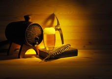 Barrel and glass of light beer on a wooden background Stock Photos