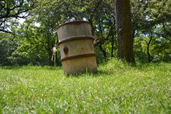 Barrel in the grass among the trees Royalty Free Stock Photography