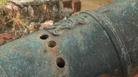 Barrel Gun Holes, Fort Cornwallis, Georgetown. Extreme close-up low-angle still shot of cannon gun barrel with pressure release holes on a historic wall, Fort stock video