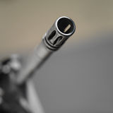 Barrel of a Gun. Looking down the barrel of a non identifiable machine gun, shallow depth of field square shot Royalty Free Stock Image