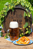 Barrel with hops and a large glass of beer Royalty Free Stock Image