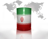 Barrel with iranian flag. On the world map background Stock Photo