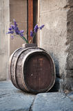 Barrel and lavander. In the front of one suvenire shop in the centre of Florence. This barrel,the wall and the pavement look very rustic Royalty Free Stock Photography