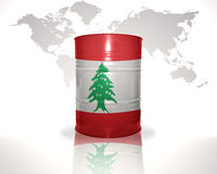 Barrel with lebanese flag on the world map Royalty Free Stock Photography