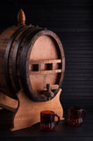 Barrel of liquor. Barrel of liquor with glasses on a black background and support Royalty Free Stock Photo