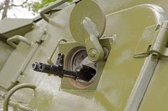 Barrel of machine in embrasure of armoured troop-carrier wheeled. The barrel of the machine in the embrasure of armoured troop-carrier wheeled stock photo