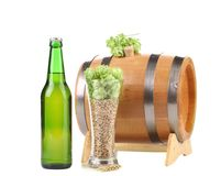 Barrel mug with hop and bottle of beer. Stock Image