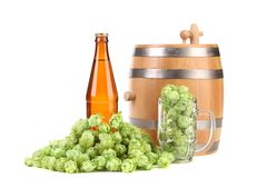 Barrel mug with hop and bottle of beer. Royalty Free Stock Photo