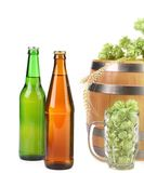 Barrel mug with hop and bottle of beer. Stock Photography