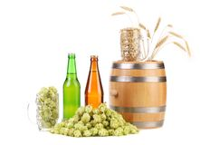 Barrel mug with hops and bottle of beer. Royalty Free Stock Photos