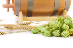 Barrel mug with hops and bottle of beer. Royalty Free Stock Photography