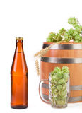 Barrel mug with hops and bottle of beer. Stock Photo