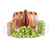 Barrel mug with hops and bottle of beer. Stock Photos