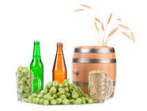 Barrel mug with hops and bottles of beer. Royalty Free Stock Photos