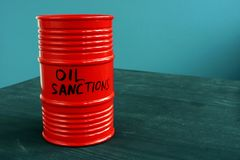 Barrel of oil with word sanctions. Red barrel of oil with word sanctions royalty free stock images
