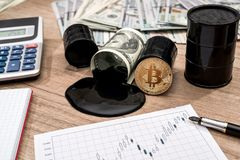 Barrel of oli, dollar, bitcoin, calculator. And pen stock images