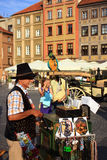 Barrel organ man with parrot. On the square of old city in Warsaw in the summer Stock Photography