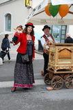 Barrel organ player and puppet miniature Royalty Free Stock Photography