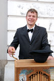 Barrel organ player smiling Royalty Free Stock Photo