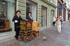 Barrel organ players Royalty Free Stock Photography