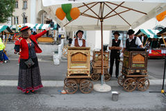 Barrel organ players and puppet miniature Royalty Free Stock Photography
