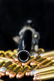 Barrel of a pistol and bullets Stock Image