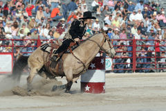 Barrel Racing. A woman barrel racing at the rodeo Royalty Free Stock Image