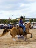 Barrel Racing. A woman barrel racing at the rodeo Royalty Free Stock Image