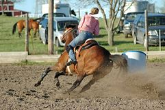 Barrel Racing. Woman riding her horse during a barrel racing event at a horse show stock photography
